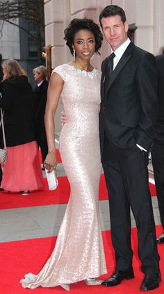 Heather Headley (singer and Broadway actress) and husband on the red carpet. (Her dress is gorgeous!)