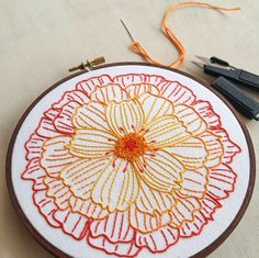 From Cozy Blue: from my original line drawing of a marigold flower blossom, this bold design is an easy and fun stitching project for advanced (or patient) beginners. | Textillia.com