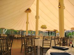 Draping of the center poles for easy elegance at a tented venue.