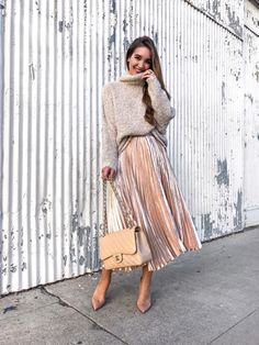 Sweaters and midi skirts... I can't quit! This rose gold skirt is like a dream... under $45 and fully stocked. How fun would it be for NYE? It runs TTS and would look just as fab with a crop top.Shop the look with @liketoknow.it: http://liketk.it/2pEjt // #ltkholiday #weekendstyle #ltkunder50 #liketkit