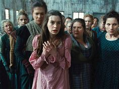 "Les Mis (2012) | Philly.com says, ''Les Mis will please its legions."" Pictured  Anne Hathaway (Fantine) and the cast of Les Misérables, the movie."