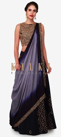 Buy Online from the link below. We ship worldwide (Free Shipping over US$100) Click Anywhere to Tag Navy blue lehenga in raw silk embellished in heavy cut dana work only on Kalki Make that memorable moment come to true as you walk in this glamorous lehenga in navy blue. The lehenga is featured in raw silk fabric giving you all the comfort you desire for. It is embellished to the core perfection with heavy cut dana embroidered work. The navy blue ready stitched blouse is fully designed using…
