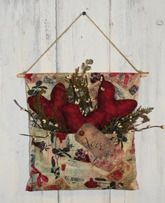 I have handmade this vintage red tone print wall pouch hanger. I added three of my primitive hearts with sweet annie and primitive ivory berries with a grungy tag with Love. Comes with a jute and wood hanger at the top.   Nice primitive accent for your valentine wall decor.  Measures approx 11 x 11    READY TO SHIP IN 2-3 DAYS