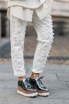 White pearl detailing on white jeans