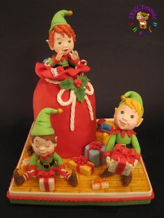 Christmas elves - Cake by Sheila Laura Gallo ... though this says it's a cake, it would be cute done in polymer clay.