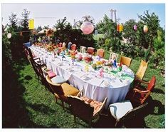 Look how colorful and fun this outdoor tea party is.  Borrow tea sets from anyone you know.  Mix and match and break the rules :-)