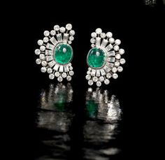 A pair of emerald and diamond earclips, circa Photo: Bonhams. Each crescent-shaped earclip set with a central cabochon emerald. Emerald Earrings, Emerald Jewelry, Diamond Jewelry, Stud Earrings, Art Deco Jewelry, High Jewelry, Jewelry Design, Women Jewelry, Bracelets