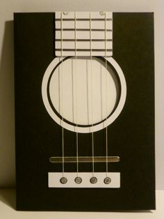 Guitar themed birthday card with sound hole, pick-ups and strings detail