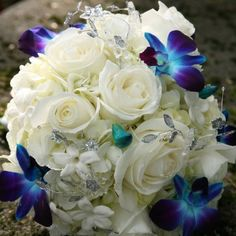 I like the white flowers with spots of color...pretty for the bridesmaids...white roses with dark blue hydrangea sprinkled in