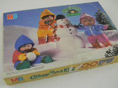 I am POSITIVE I had this as a kid and NEED to track it down!  Cabbage Patch Kids Puzzle