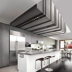The daylight not only helps illuminate the home, but also animates a zinc ceiling installation suspended above the kitchen.