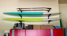 paddleboard garage storage rack for 3 SUPs #supstorage #indoorstorage #storeyourboard