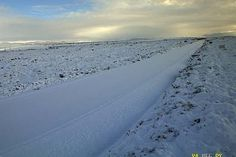 Snow blankets the summit of the Desert Road on Sunday, August 9