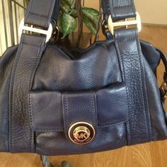 Authentic Michael Kors Handbag This beautiful blue leather MK purse, front pocket with gold hardware has been used a few times. Some wear to the front pocket hardwear and inside pocket has a rip but not noticeable unless you open it. Please see picture. Michael Kors Bags Shoulder Bags