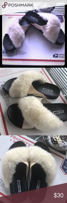 Faux fur trim slides ! Like new condition Worn twice! Cream color faux soft fur and patent leather ! Black padded soles. Med width cape robbin Shoes Sandals