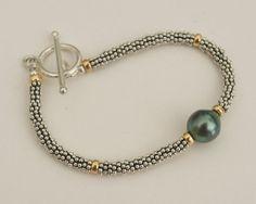 Great Tahitian pearl bracelet!!  Etsy listing at https://www.etsy.com/listing/160022053/tahitian-pearl-and-silver-bali-bead