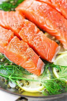 Fresh salmon in a skillet with aromatics for poached salmon Recipe For Poached Salmon, Seafood Recipes, Appetizer Recipes, Salmon Skillet, Party Entrees, Lemon Caper Sauce, Lemon Salmon, Hollandaise Sauce, Salmon Dishes