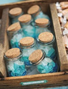Bottled seaglass candy is such a fun (& tasty) wedding favor! || Bella Collina Weddings