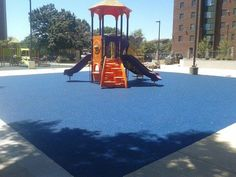 No Fault Sport Group partnered with Commercial Recreation Products, LLC to provide our No Fault Safety Surface for the playground areas at the Tyler House Apartments in Washington, DC. They chose a stunning blue color for the poured-in-place rubber surface that complements the attractive play equipment in colors of red, orange and blue. The surface is so smooth it looks like carpet!