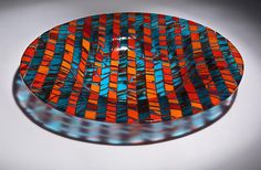 """By Varda Avnisan.  """"Fire And Water"""".  Fused and slumped glass bowl in orange and turquoise. Sheets of art glass are created and fired, then cut and assembled to create this vivid bowl. Sandblasted to create a satin finish. Dimensions: 2.5in Hx18.25in diameter  $1200.00.  More @ http://artglassdesignstudio.com/vessels.php"""
