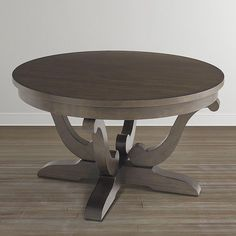 This round wood coffee table is inspired by the rustic styles found in the French countryside, where artisans used local woods and unpretentious finishes.