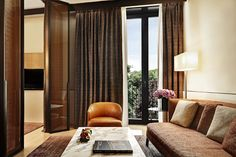 Discover a spacious haven of exquisite Italian craftsmanship in our luxury hotel Superior Suites at the Bvlgari Hotel Milano, in Italy Bulgari Hotel Milan, Bvlgari Hotel, Milan Hotel, Hotel Specials, Hotel Interiors, Floor To Ceiling Windows, Cozy Living Rooms, Cool Rooms, Contemporary Furniture