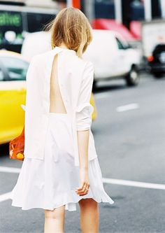 An open back button-down blouse is worn with a matching white skirt #trendygirl