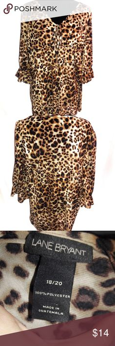 Plus Size 18/20 Lane Bryant Cheetah Tunic Shirt Size 18/20 Lane Bryant brand cheetah/leopard print tunic. Elastic band at the center. 100% Polyester, thin sheer-like material. Good used condition with no major flaws. All items are from a pet free, smoke free home and will ship same or next day. Lane Bryant Tops