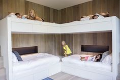 One solution for the children's room at the cottage: sleek, white bunk beds that accommodate the whole brood.