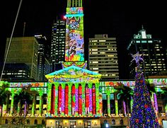 Where is it: King George Square, Brisbane City What's it all about: It's a short movie projected onto the outside City Hall! How can I join in: Every 15 minutes they show the same little story - so just roll on up to King George Square any time aft Hall Lighting, Brisbane City, King George, Times Square, The Outsiders, Around The Worlds, Join, Australia, Christmas