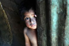 Sept. 7: A hungry, tear-stained Guatemalan boy peers around a wall of his modest home.    Countries like Guatemala and Haiti have some of the highest child malnutrition rates in our hemisphere, but Food For The Poor has an incredible new opportunity to save precious lives: For a limited time, every $1 a donor gives will translate into $ 17.52 worth of food and other aid for hungry families.    Please help: www.foodforthepoor.org/shippingemergency.