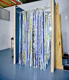 "Hosting a house party and want to make sure your guests feel the party spirit right from the start? We've been calling this ""the mood portal"" it's made by hanging lengths of textiles over shower curtains. Best thing is it's impossible to walk through without feeling like a rock star."