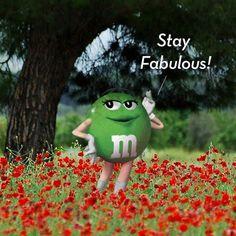 Green M&M in a field of wildflowers