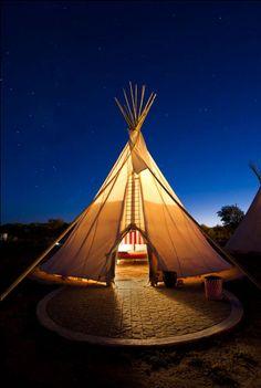 El Cosmico // Marfa, TX // Here, one of El Cosmico's three teepees is a lantern for desert travelers.