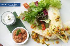 #Mexican #breakfast #scrambled #eggs #chicken #fajita #tortilla #wrap #bakedbeans #tomato #mango #salsa #sourcream