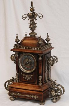 Antique French Wooden Mantle Clock With Silvered Bronze Mountings And Feet,   c. Late 19th Century.