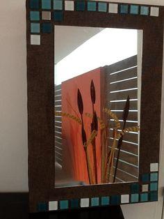 Espejo decorado con venecitas