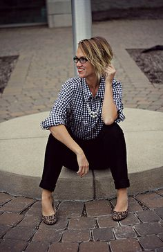 Checkered shirt and leopard flats.