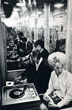 vintage b/w photo -people listening to records