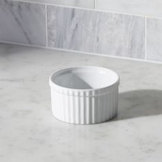 Shop Short Ramekin.  Durable, ribbed white porcelain adds classic style to a variety of foods.  Ramekins can be used to bake individual desserts, serve snacks or pre-measure cooking ingredients—the uses are endless.