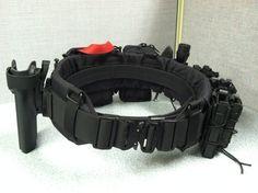 "1.Padded War Belt 2.Ares Gear Duty Belt LE 1.5"" (Inner/Hook) (Large) 3. (3) HSGI Double ""TACO"" Modular Single Rifle / Single Pistol Magazine Pouch 4.  (2) HSGI ""Pistol TACO"" Single Universal Pistol Magazine Pouch (Flashlight / MultiTool) 5. HSGI Radio/Utility Modular Pouch 6. EGL Gen II Molle Loppy Dump Pouch 7. ITS ETA Trauma Kit (Standard) and Pouch 8. SOF Wide Tactical Tourniquet 9. Benchmade 7 Safety Cutter Hook Blade With Nylon Webbing Pouch 10. G-Code RTI Wheel 11. G-Code RTI Molle..."