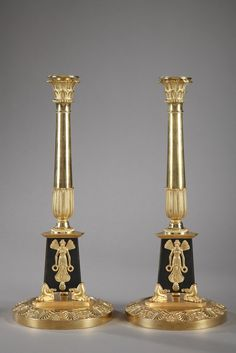 PAIR OF EMPIRE CANDLESTICKS WITH ALLEGORIES OF VICTORY Pair of gilded and patinated bronze candlesticks featuring Victory represented as a winged goddess. Circa 1810.