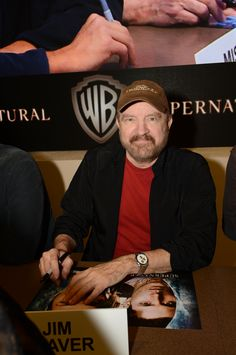 SUPERNATURAL star Jim Beaver signs for fans at the Warner Bros. booth at Comic-Con 2012 (© WBEI. All Rights Reserved.)