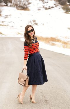 Navy skirt/dress with orange striped top and neutral accessories Blue Skirt Outfits, Winter Dress Outfits, Navy Skirt, Casual Dress Outfits, Fall Winter Outfits, Modest Outfits, Cute Outfits, Fashion Outfits, Desire Clothing