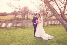 Newlyweds kiss in the garden at Sopley mill wedding. Photography by one thousand words wedding photographers