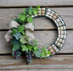 This wreath is made from recycled wine corks and is 11.5 inches in diameter. It would look great in a wine cellar, wet bar or kitchen. A perfect gift for the wine lover!  Thanks for looking #winecorks