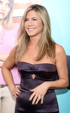 Not sure what sparkles more on Jennifer Aniston... that smile or that engagement ring! #fashion