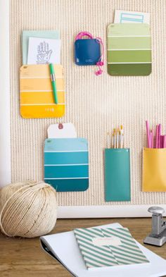 Repurpose hardware-store paint chips as pocket organizers for a bulletin board. Fill them with pencils, papers, and more.