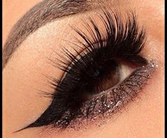 Glitter eye shadow with long black lashes. Bring out the best in your brown eyes!