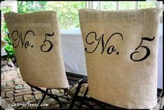 "Vintage lil garden chairs ~ A simple burlap was stitched to fit the chair backs, and then hand-painted with ""No. 5″ in black to make these great chair backs for under $7.00!"